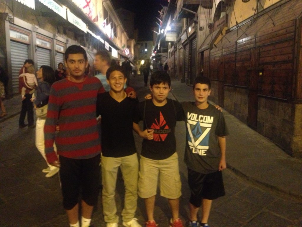 Joshua Perez (third from left) poses with three NorCal Premier Soccer trialists in Florence in 2013.